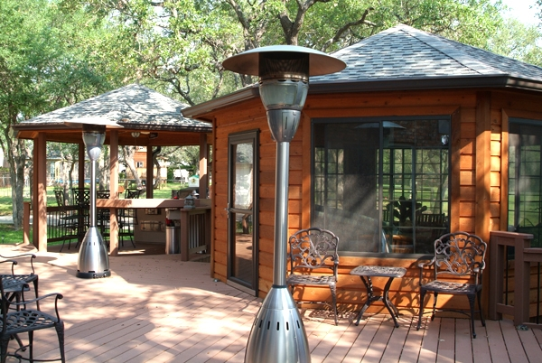 Durable composite decking combine with the warmth of cedar in this upscale outdoor living area