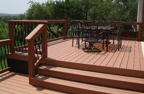 Split-Level Composite Deck with Elegant Wrought Iron Grillwork