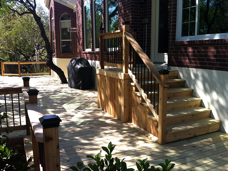 Raised Landing Leads Down Staircase to Treated Pine Deck